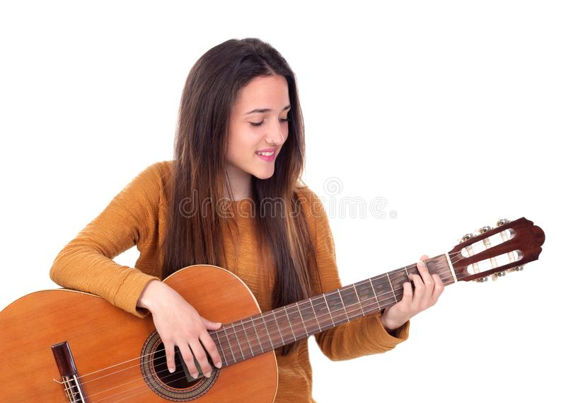 Teenager girl playing a guitar royalty free stock images