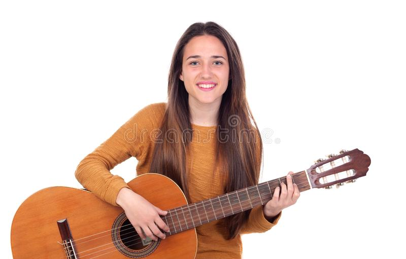 Teenager girl playing a guitar royalty free stock image