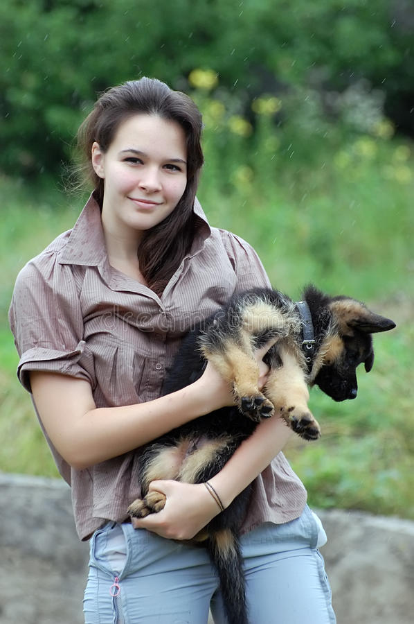 Teenager girl and puppy royalty free stock photos