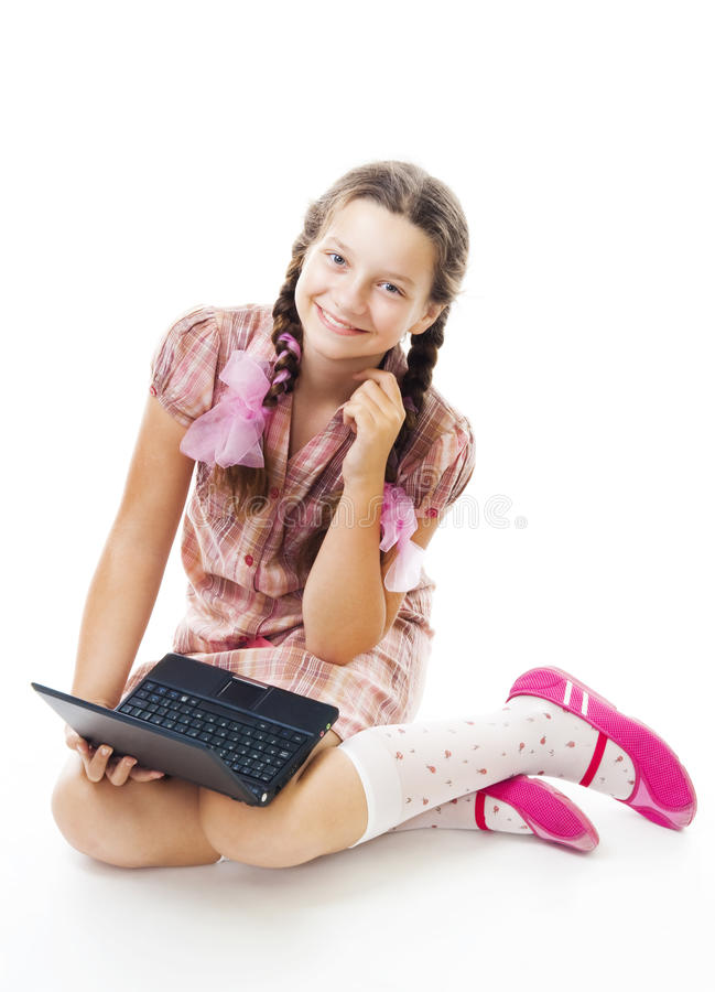 Teenager girl sit holding small laptop