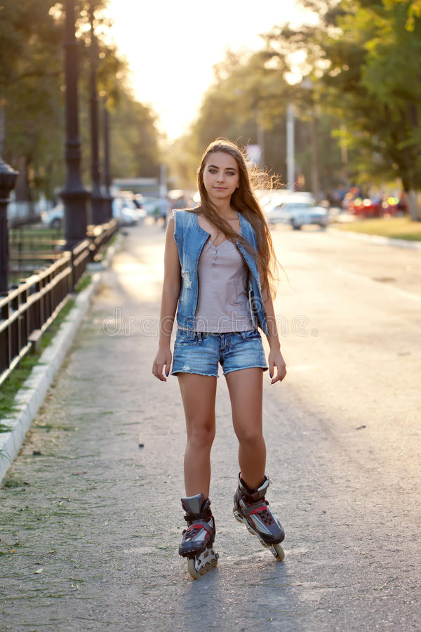 Download Teenager Girl Skating During Sunset Stock Photo - Image of people, jeans: 28020076