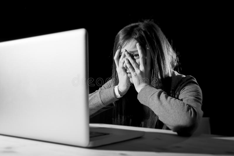 Teenager girl suffering cyberbullying scared and depressed exposed to cyber bullying and internet harassment. Feeling sad and vulnerable in internet stalker royalty free stock photos