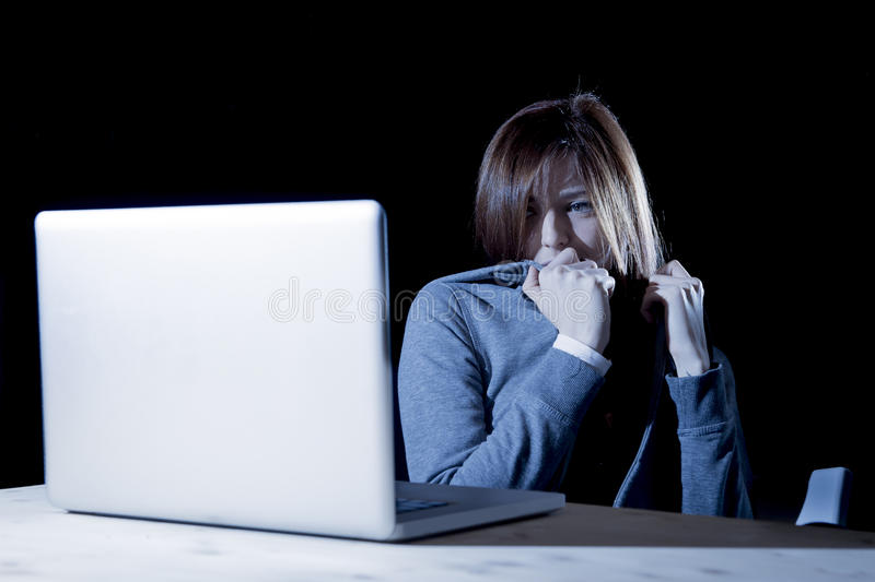 Teenager girl suffering cyberbullying scared and depressed exposed to cyber bullying and internet harassment. Feeling sad and vulnerable in internet stalker stock photos