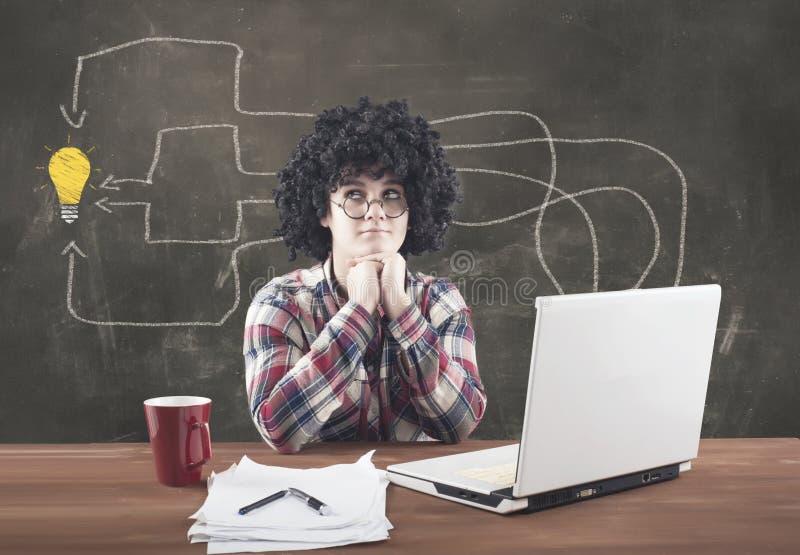 Teenager girl using the laptop computer stock photos