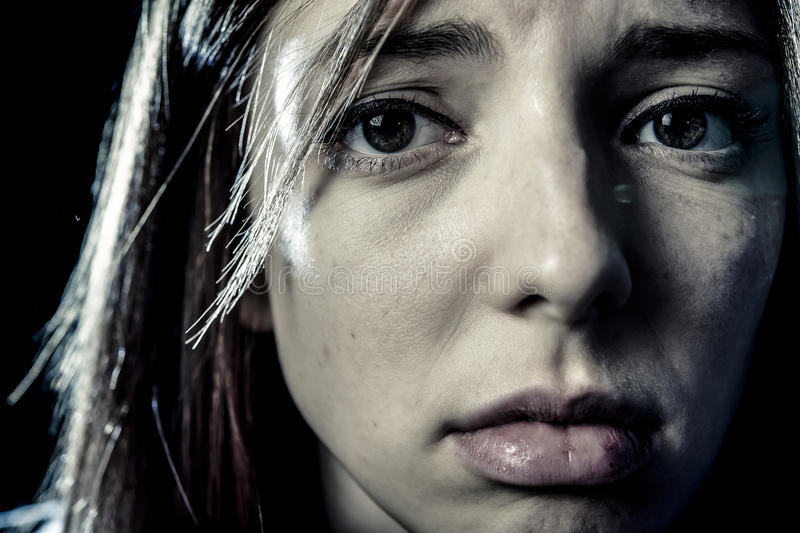 Teenager girl or woman in stress and pain suffering depression looking sad. Lonely young teenager girl or woman in stress and pain suffering depression looking royalty free stock photo