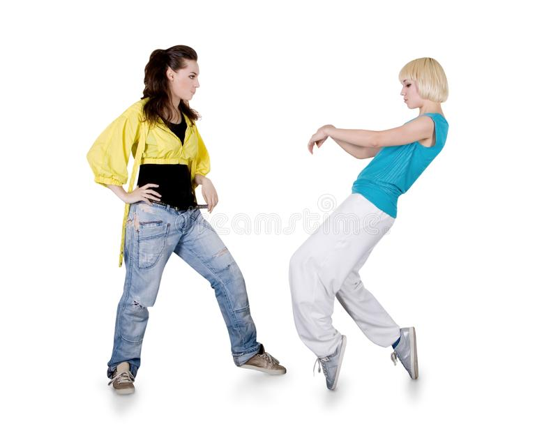 Teenager girls dancing hip-hop over white stock image