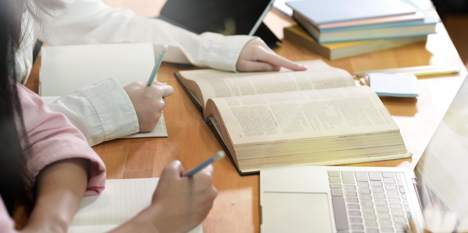 Teenager girls doing group study stock photos
