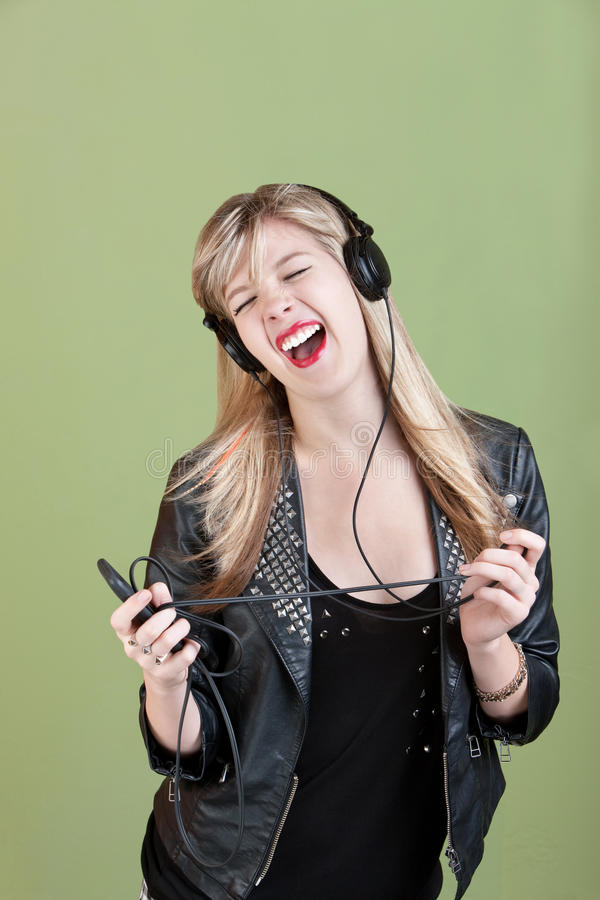 Teenager gode della musica immagine stock