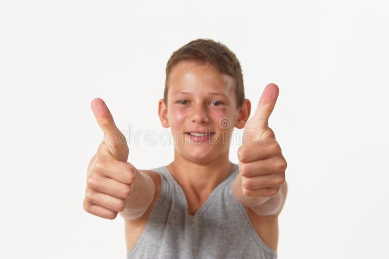 The teenager in a gray shirt. emotions of the winner. stock image