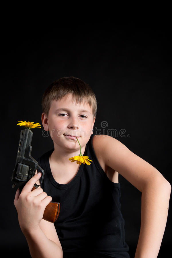 Download Teenager With A Gun And Flowers Stock Photo - Image: 32798354