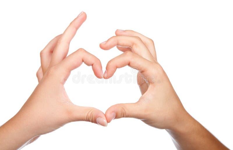 Teenager hands form a heart shape