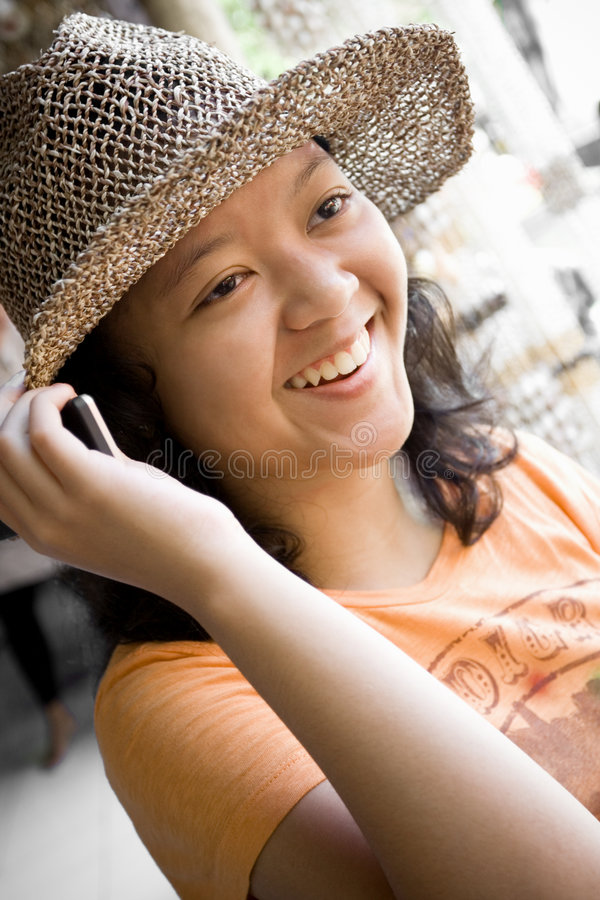 Teenager having a happy phone call stock image