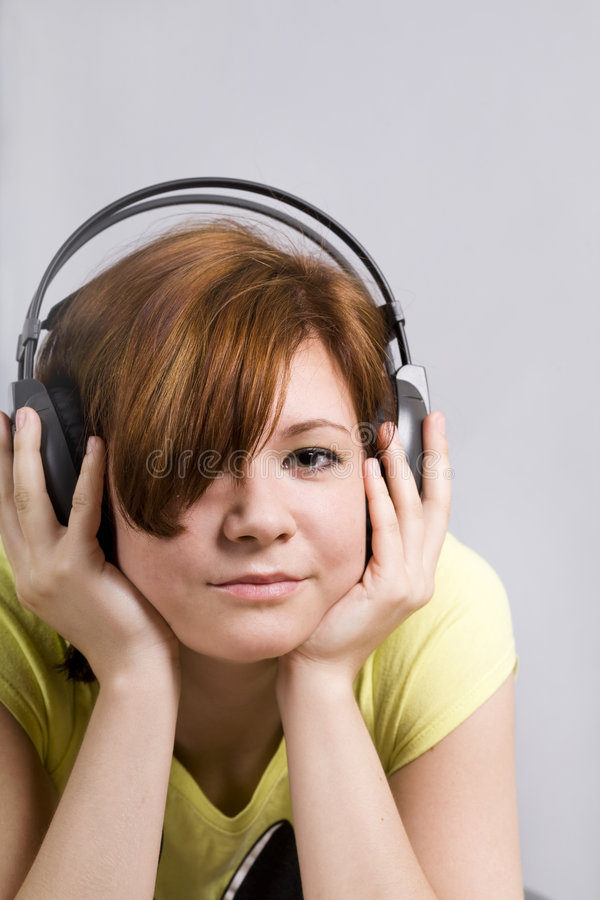 Teenager with headphones royalty free stock image