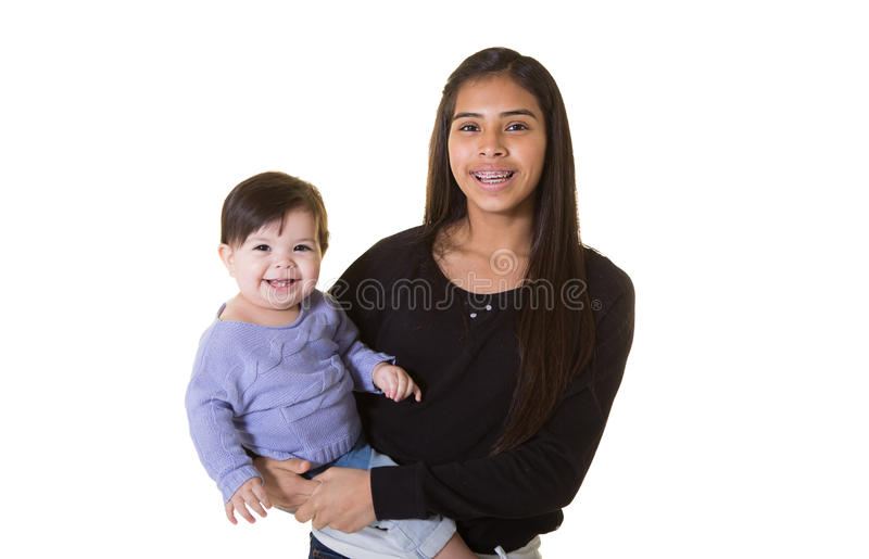 A teenager and her baby sister. Isolated on white stock photos