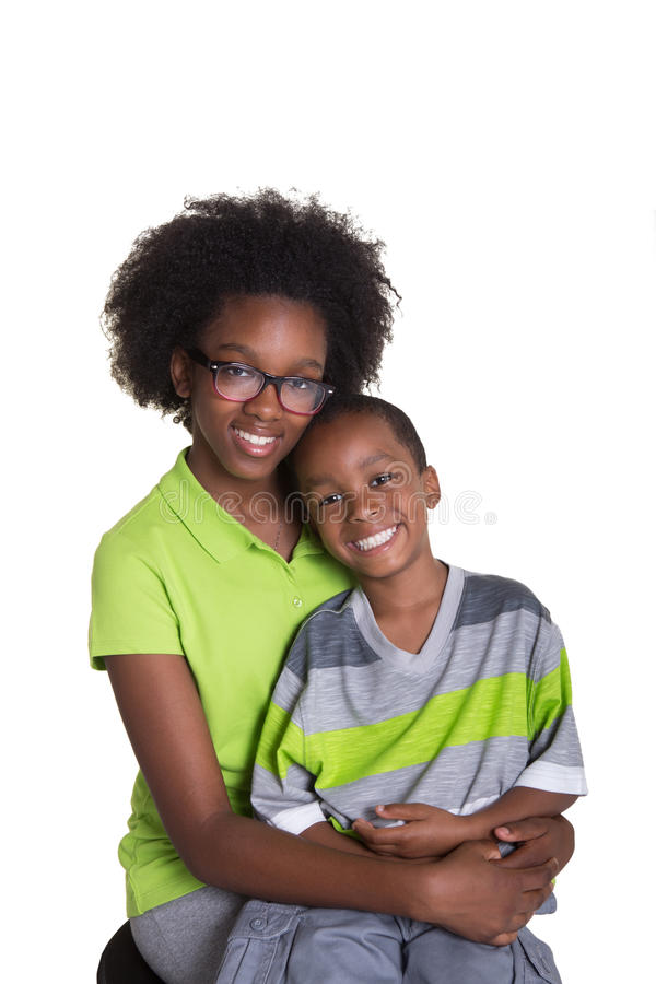 A teenager and her younger sibling. Isolated on white stock image