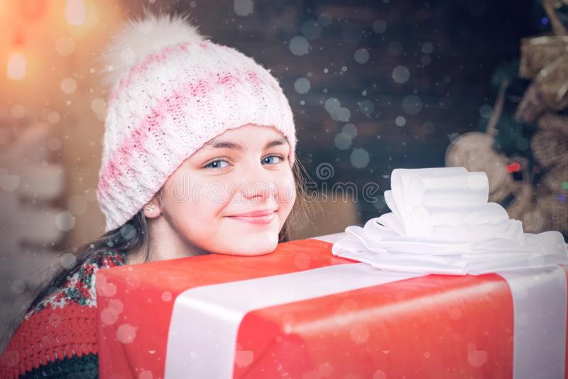 Teenager hold Christmas gift box. Happy Little girl with Christmas gift box. Cute little girl near Christmas tree royalty free stock photos