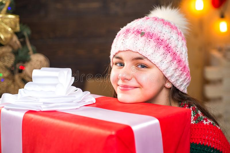 Teenager hold Christmas gift box. Happy Little girl with Christmas gift box. Cute little girl near Christmas tree stock photos