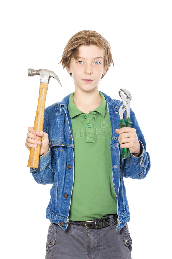Teenager holding some working tools stock images