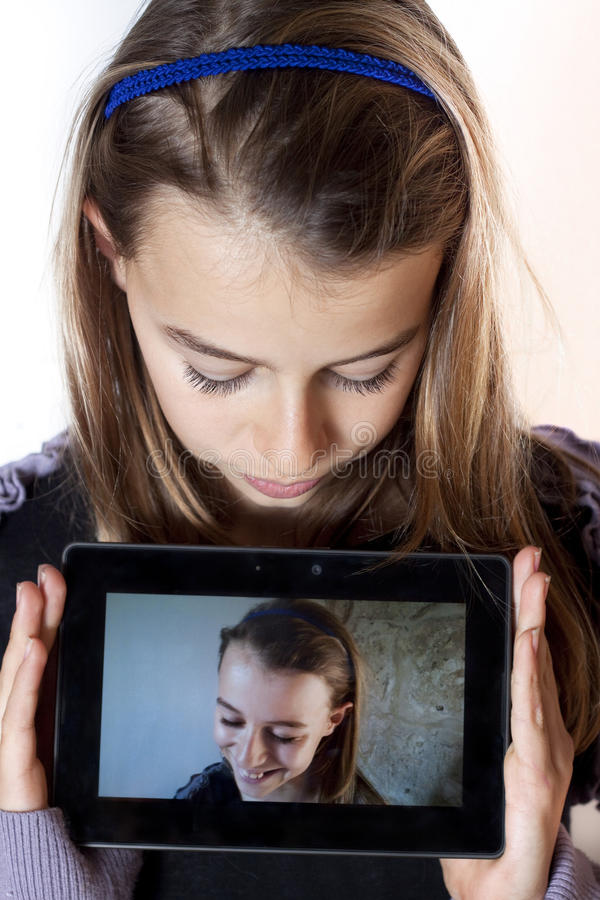Teenager holding a tablet royalty free stock photography
