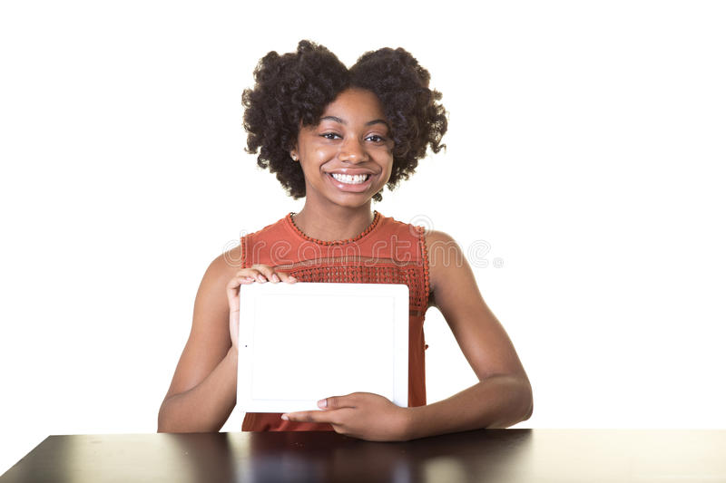 A teenager holding a tablet stock image