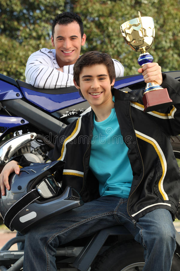 Teenager holding up a trophy royalty free stock photo