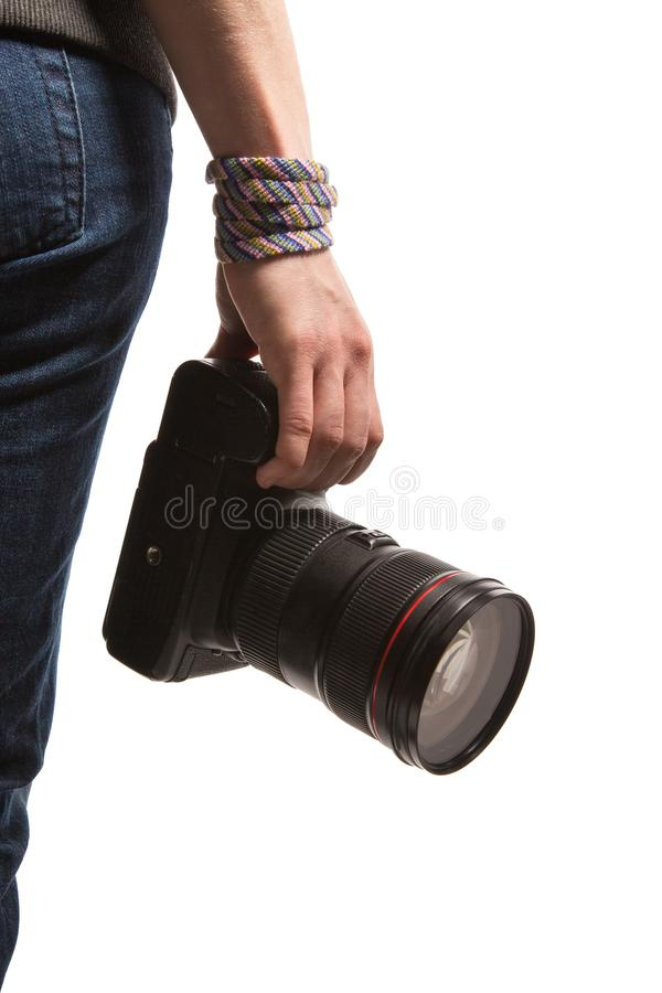 A teenager holds in her hand a DSLR camera. Isolated on white background stock images
