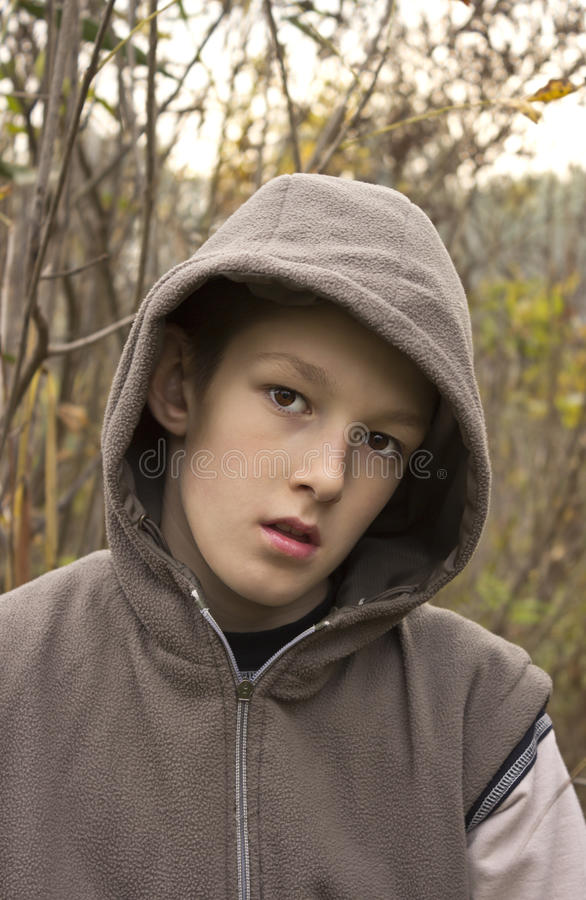 Teenager with hood. Portrait of a teenager with a hood royalty free stock photography