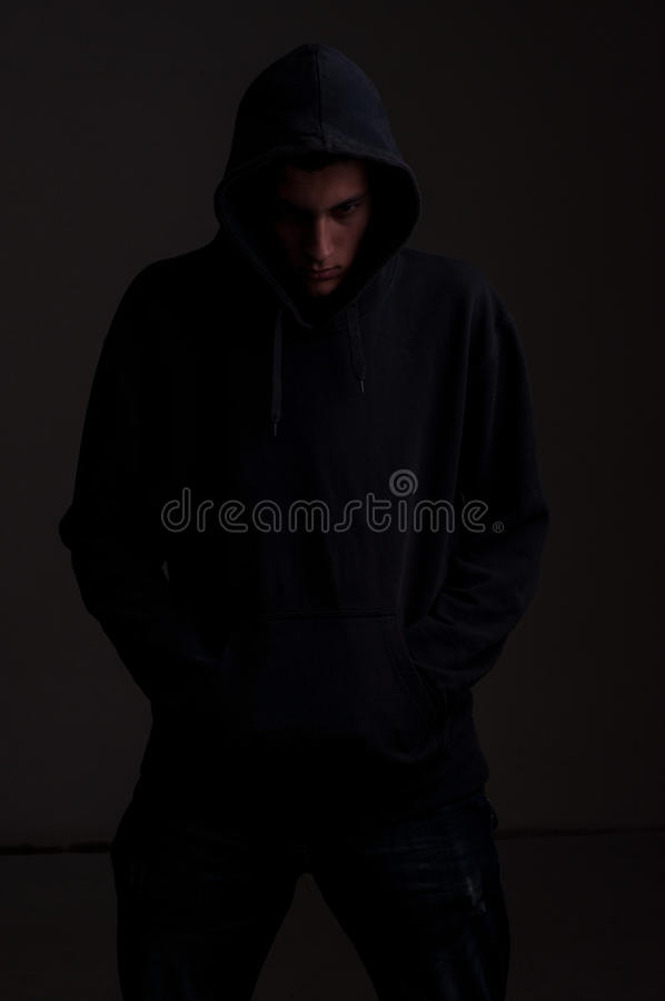 Download Teenager With Hoodie Look On One Side Royalty Free Stock Images - Image: 32685709