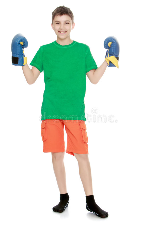 Teenager involved in Boxing. Cheerful teen boy in Boxing gloves - Isolated on white background stock photos