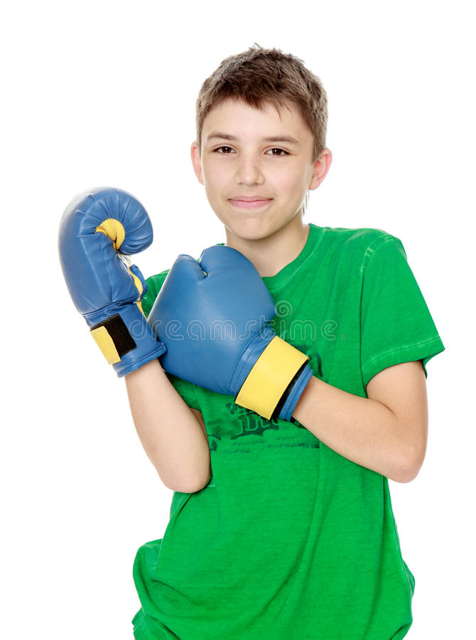 Teenager involved in Boxing. Positive teen boy in Boxing gloves. Close-up - on white background stock photography