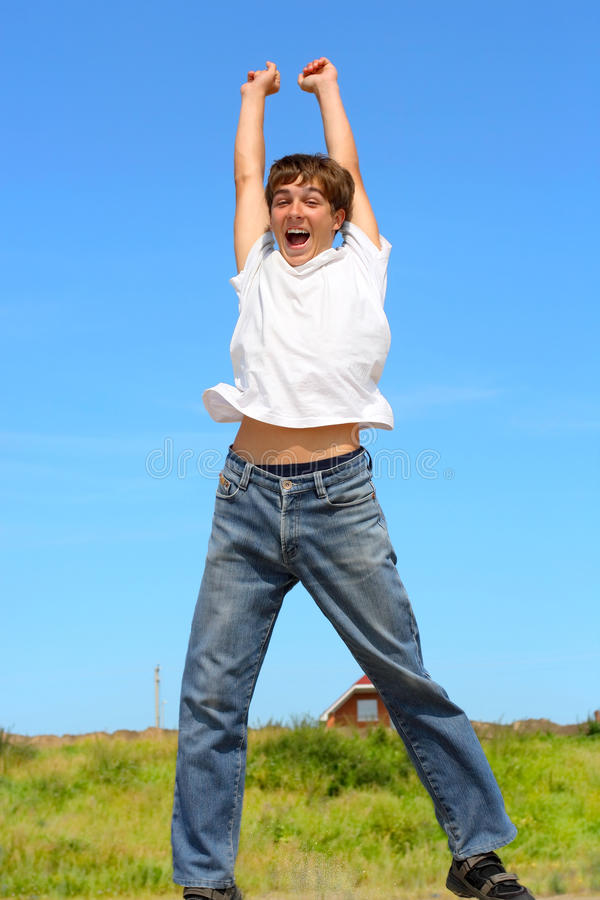 Teenager jumping. The happy teenager jumping outdoor royalty free stock photos