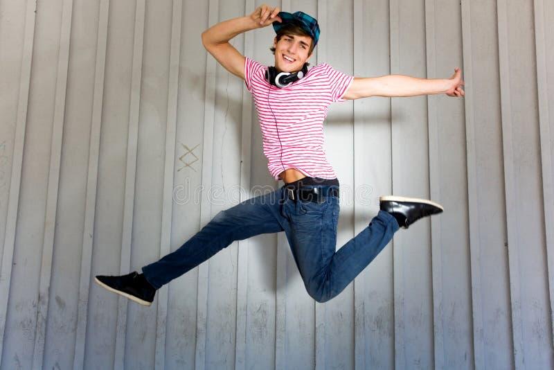 Download Teenager jumping stock image. Image of smile, midair - 15036823