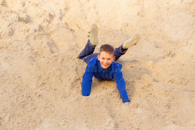 Teenager jumping against the beach. Parkour on the sand.  royalty free stock photo