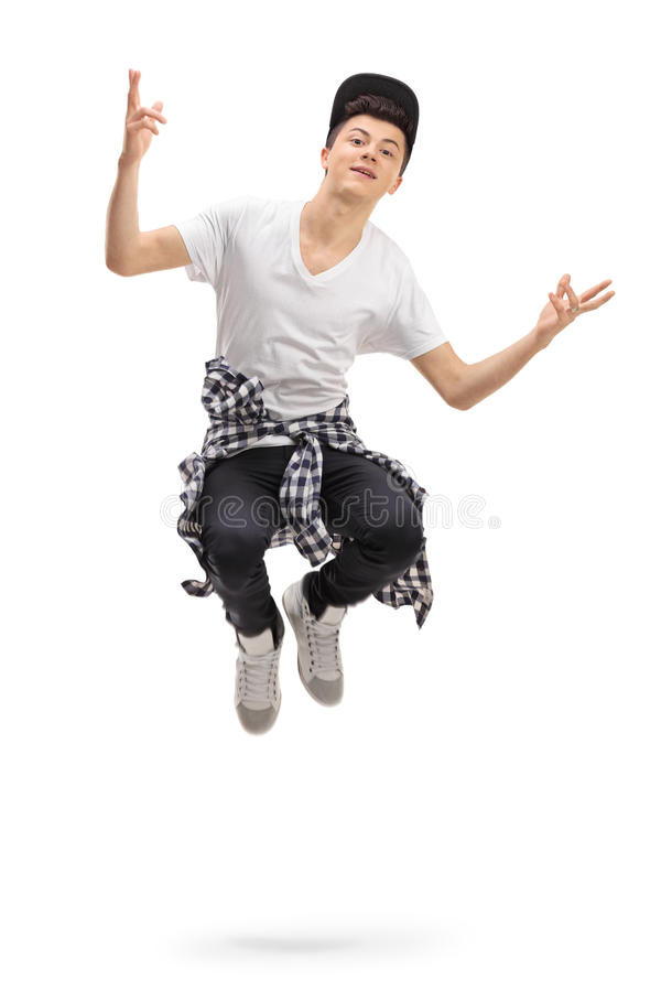 Teenager jumping. Full length portrait of a teenager jumping isolated on white background royalty free stock image