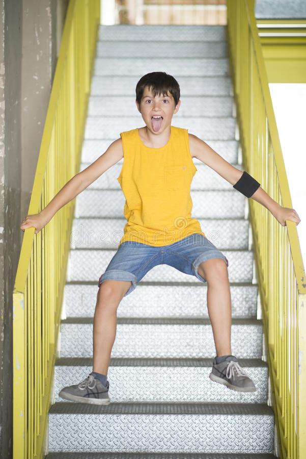 A teenager jumping on the stairs and smiling. Teenager jumping on the stairs and smiling stock photography