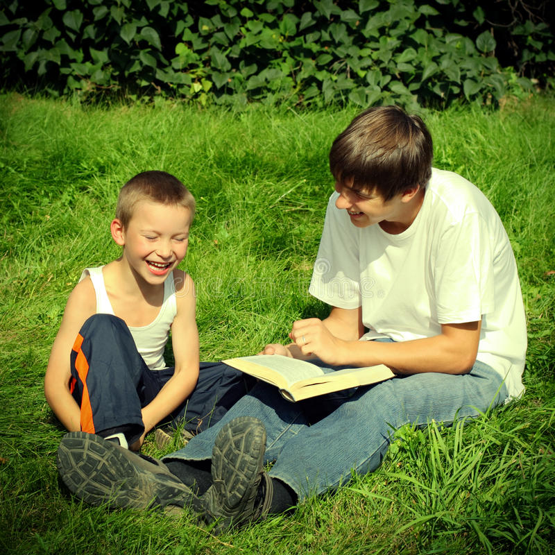 Download Teenager And Kid With A Book Stock Image - Image of cheerful, brother: 39095973