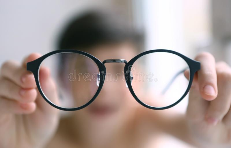 Teenager kid boy in myopia correction glasses. Close up portrait royalty free stock photos