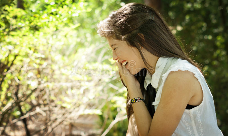 Teenager laughing in a park stock images