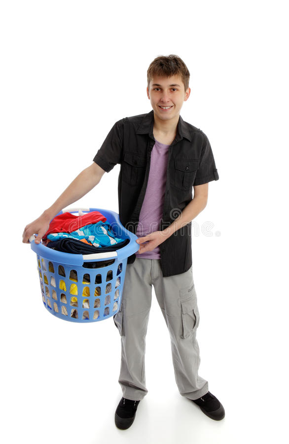 Teenager with laundry. A teenage boy holding a basket of laundry. White background royalty free stock photos