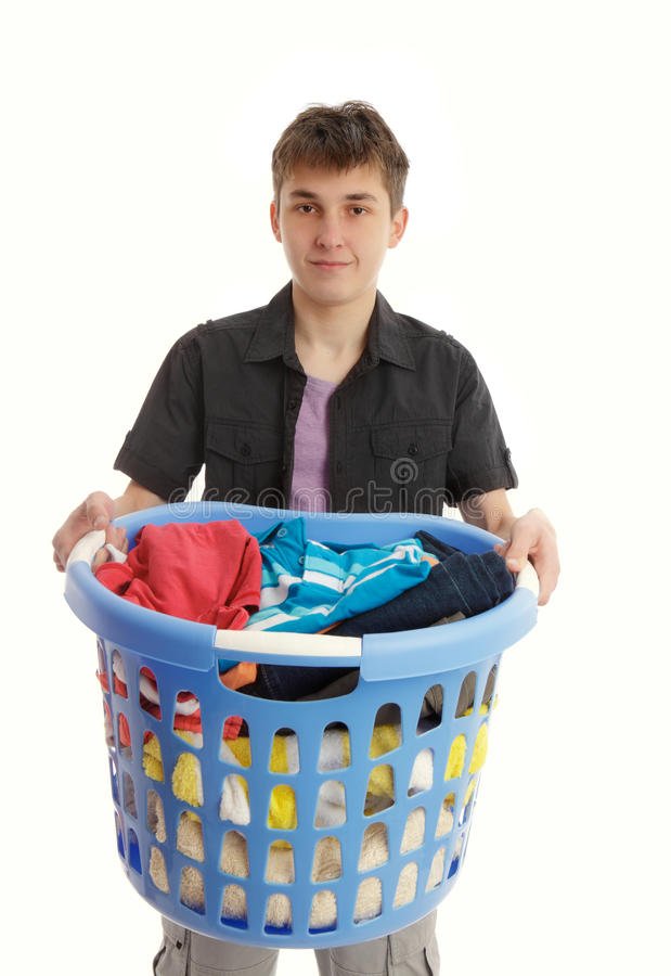 Teenager with laundry basket. Teenager holding a blue laundry basket stock images
