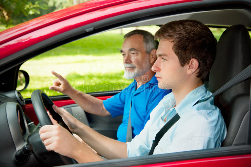 Teenager learning to drive stock photos