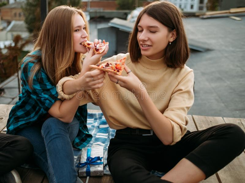 Teenager leisure taste food pizza balanced eating. Teenagers leisure. Time to eat delicious food. Hungry young people taste pizza slices. Balanced eating is not stock images