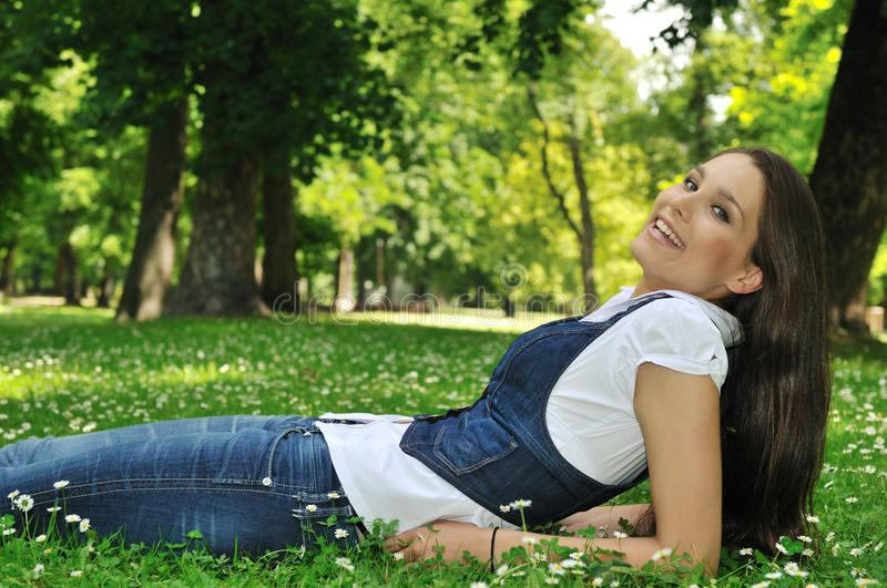 Teenager lying in grass