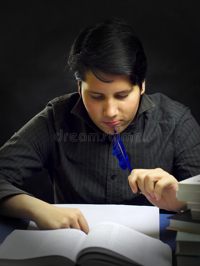 Download Teenager Male Thinking By Books With Feather Stock Photo - Image: 22755648