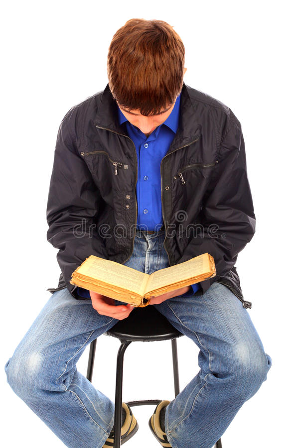 Teenager With Old Book Stock Images