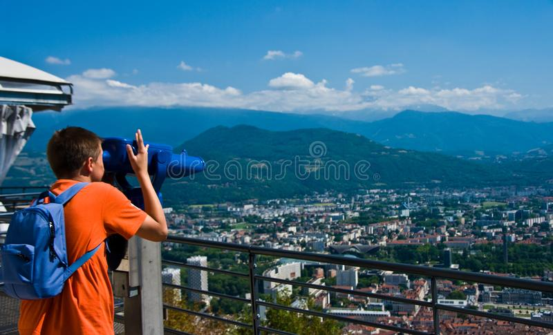 Teenager looking at Grenoble from Bastille royalty free stock image