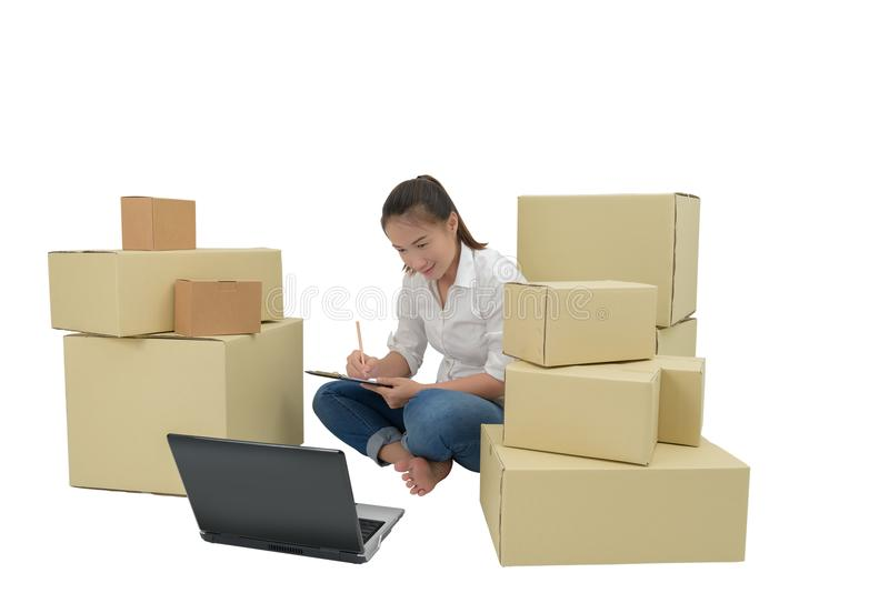 Teenager owner business woman work at home with Clipboard, laptop for online shopping writing the order. Isolated on white background with clipping path royalty free stock photo