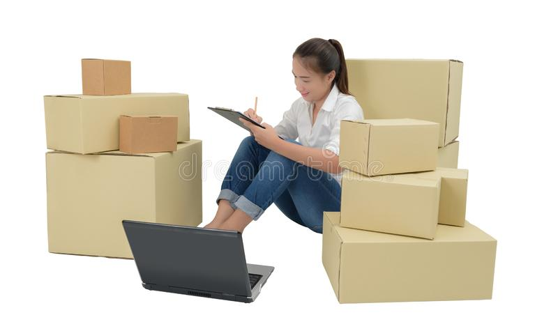 Teenager owner business woman work at home with Clipboard, laptop for online shopping writing the order. Isolated on white background with clipping path stock photo