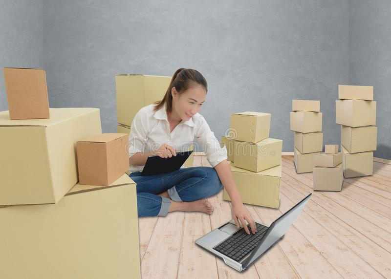 Teenager owner business woman work at home with Clipboard, laptop for online shopping writing the order. Teenager owner business woman work at home or office stock photos