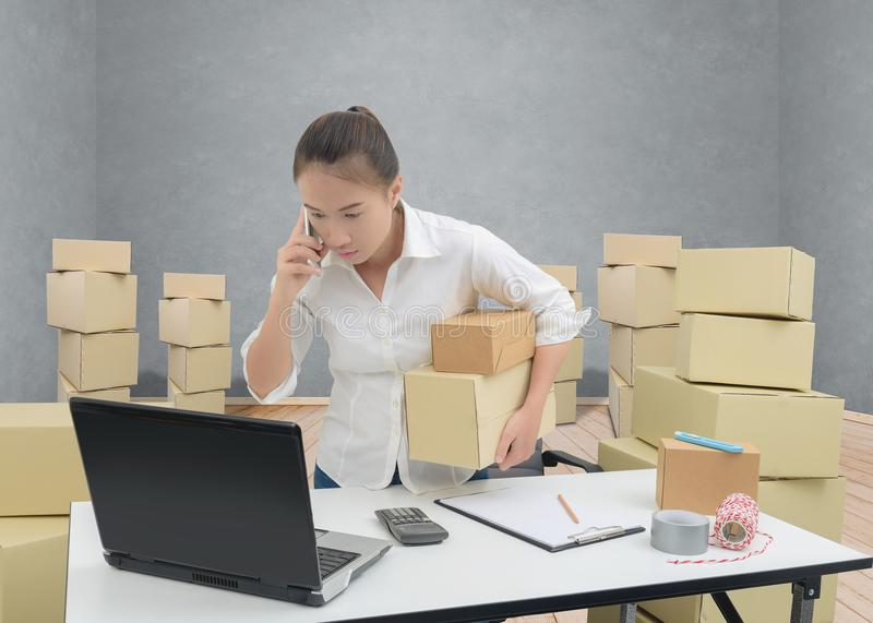 Teenager owner business woman work at home with smartphone, laptop for online shopping writing the order. Teenager owner business woman work at home or office stock photo